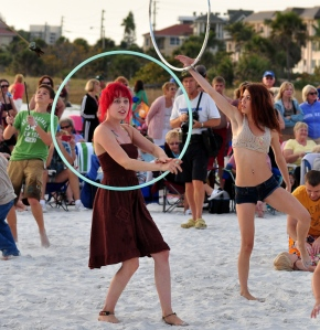 Dancers join in the fun using hoola hoops.