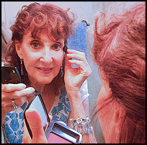 Applying my make-up, not too much, not too little.