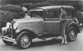 This old photo shows what the old Hupmobile looked like and the woman looks much like my husband's mother.