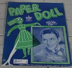 "Old sheet music of ""Paper Doll."""