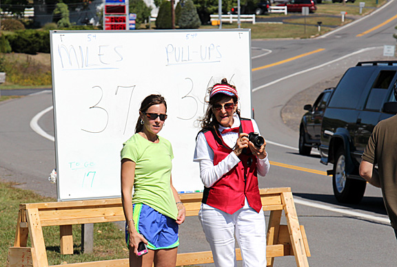 This was the score board where each completed mile was recorded. I' pictured in the red vest.