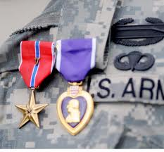 The V for valor award is to the left.