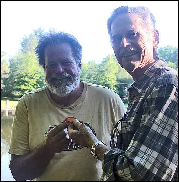 Here's Burl presenting Duane (left) with the specially made penny holder.