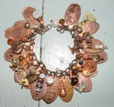 A bracelet made from pressed pennies.