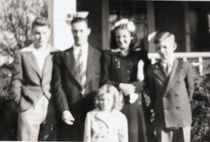 I'm pictured here next to my dad, with siblings on each side and in the front. Taken about 1946.