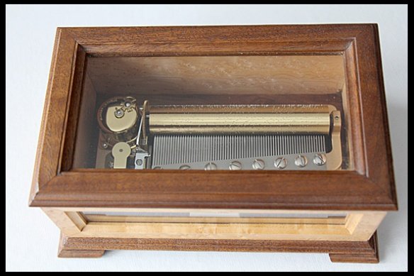 This music box plays three classical pieces.