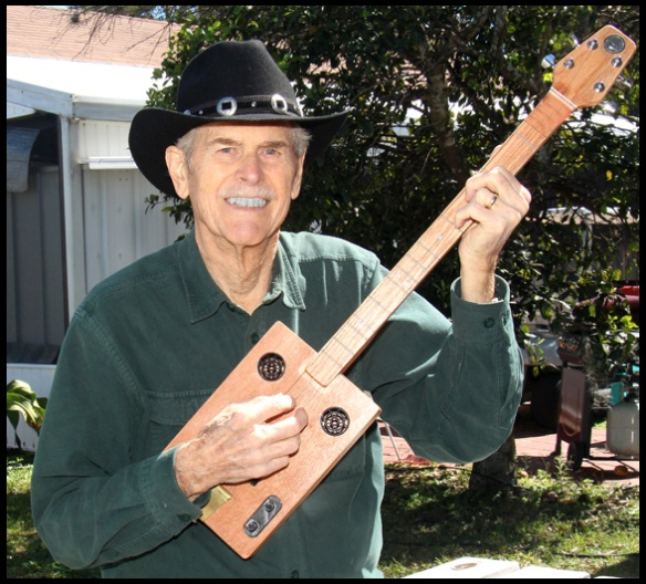 My husband, Burl, with the first Cigar Box Guitar he built. Mine was the second.