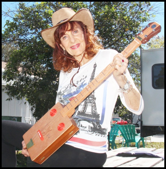 Here I am showing off my  Cigar Box Guitar.