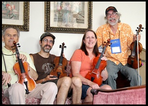 Burl, left, is pictured with his fiddle class.His teach, Michael Ismerio sits next to him, Donna Turner and Scott.